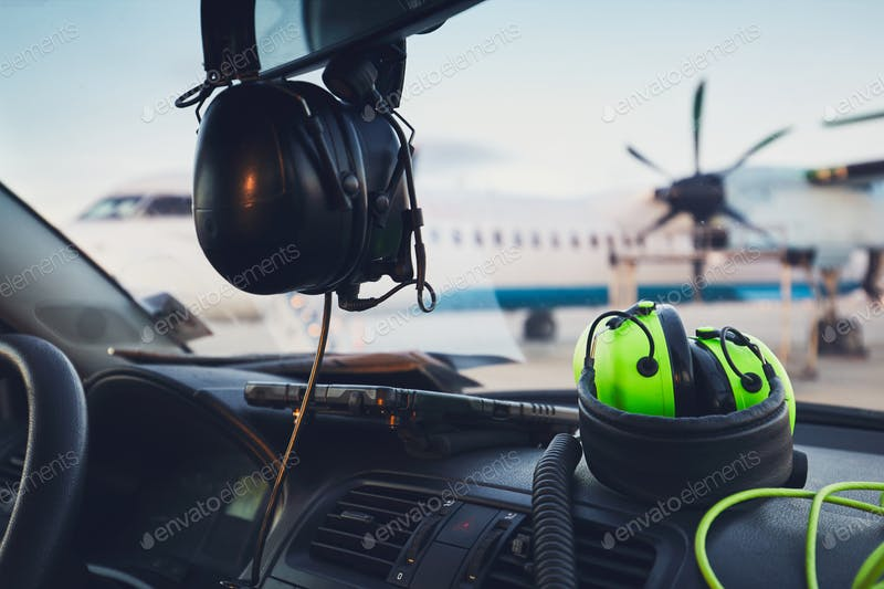 Headphones In A Vehicle Mockup