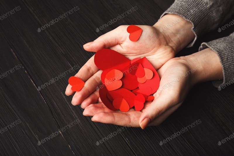 Hearts in Female Hands With Wooden Background Mockup.