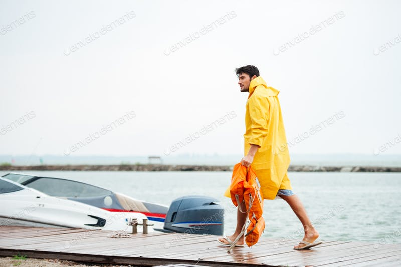 Man Holding Life Vest At Pier Template.