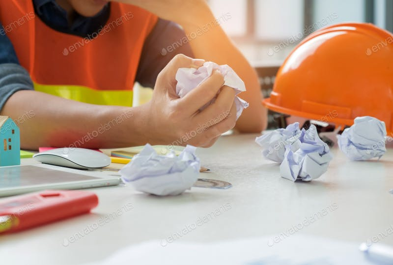 Man With Rough Paper And Orange Helmet PSD