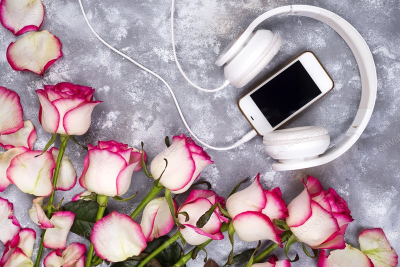 Mobile And Headphone In A Composed Frame Of Roses Mockup.