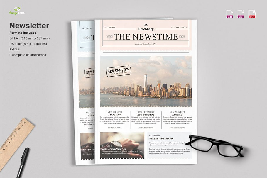 Newsletter With Specs And Ruler Kept Beside