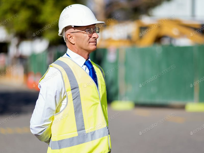 Old Builder At Construction Site In Yellow Safety Vest PSD.