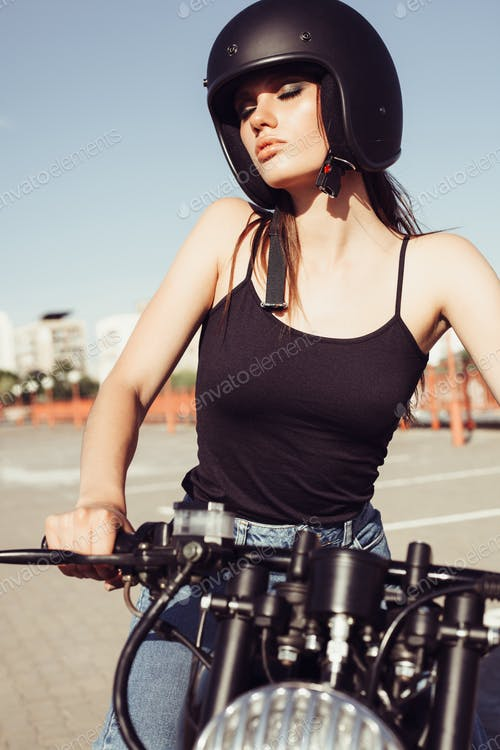Picture of A Girl Wearing Black Helmet And Riding Bike