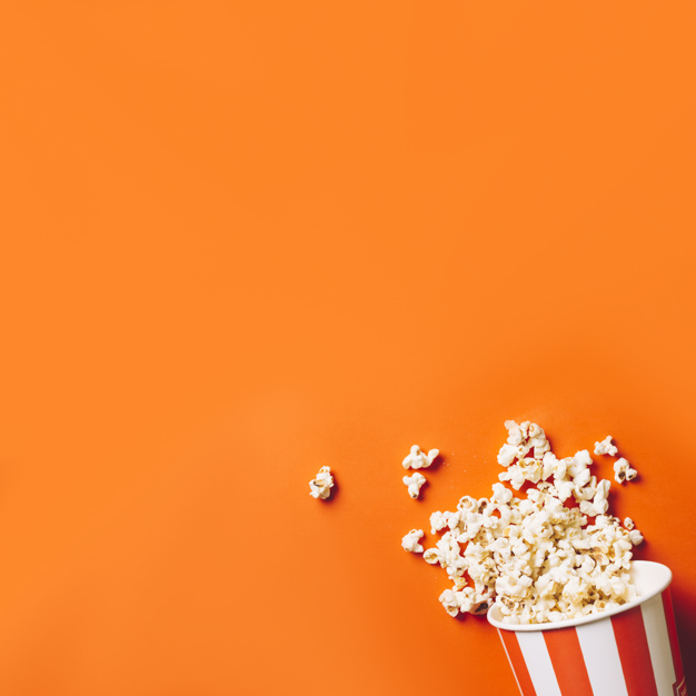 Popcorn bucket over an orange background Picture