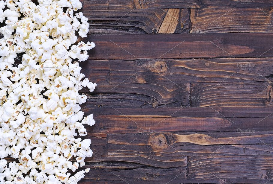 Popcorn on a wooden Background Mockup