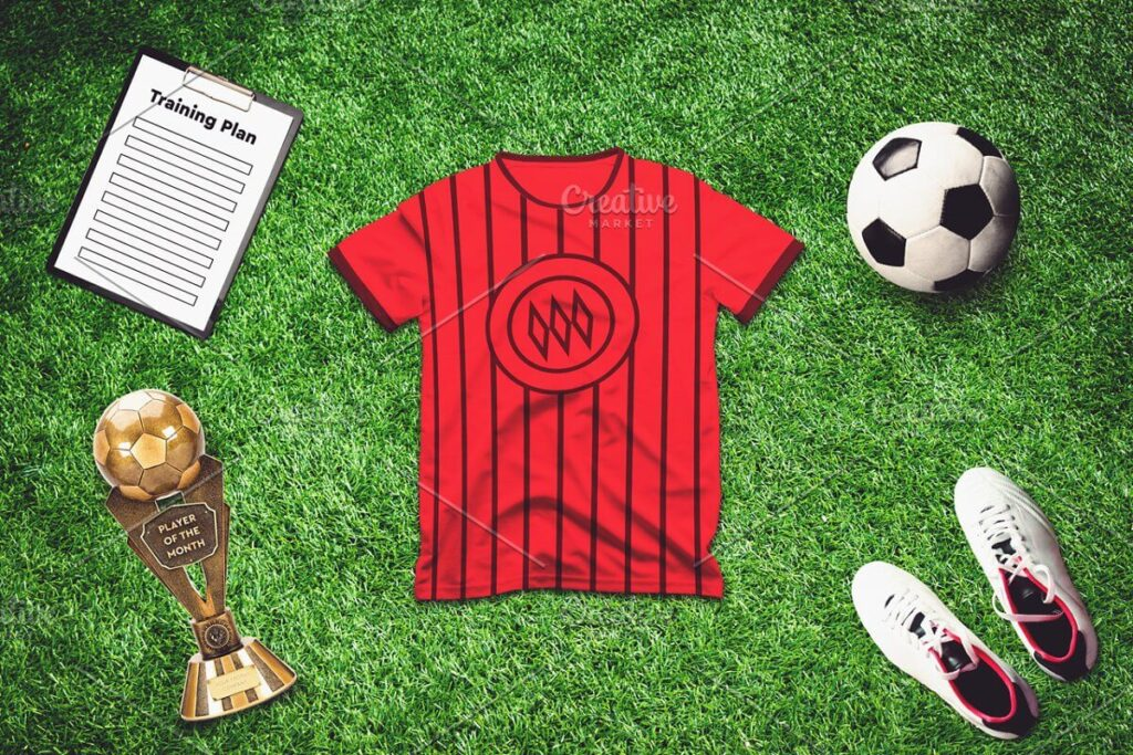 Red Color soccer T-Shirt With Ball Kept Beside Mockup