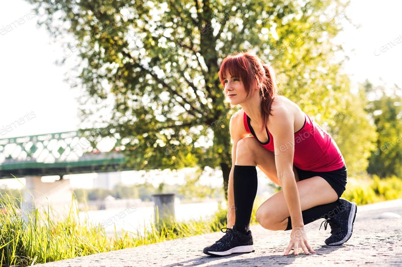 Runner Girl In Red Tank Top At the City Park PSD