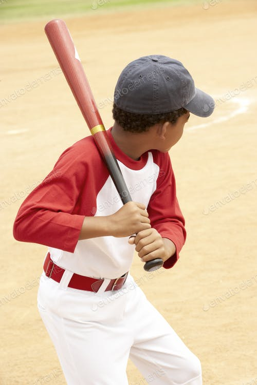 Small boy Wearing Baseball Cap And Playing Baseball