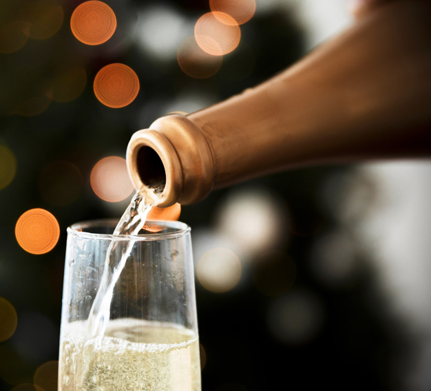 Sparkling Wine Pouring Out Of In A Glass Template
