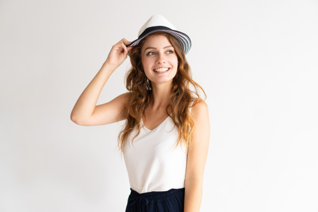 Stylish Young Woman Posing In Tank Top With A Hat PSD