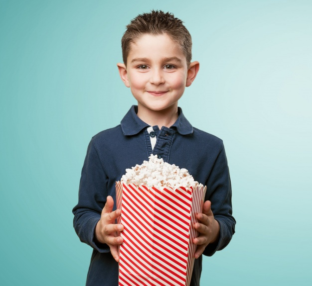 Sweet Kid holding popcorn bucket Picture