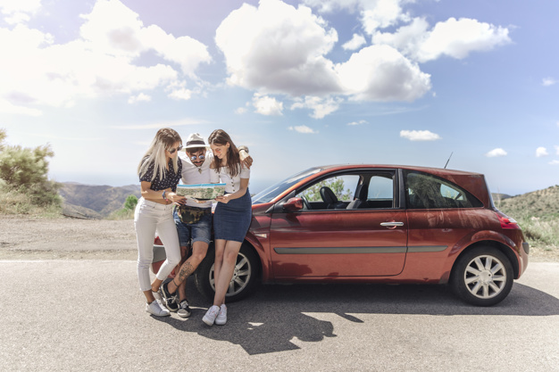 Three Friends Looking At The Map Near a Modern car mockup.