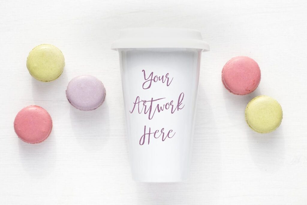Travel Mug Placed With Some Macaroons PSD File