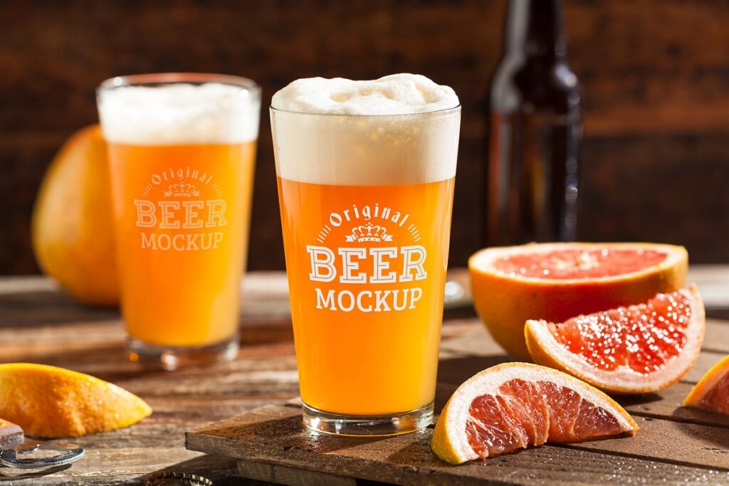 Two Beer Glass With Oranges Kept Beside Mockup