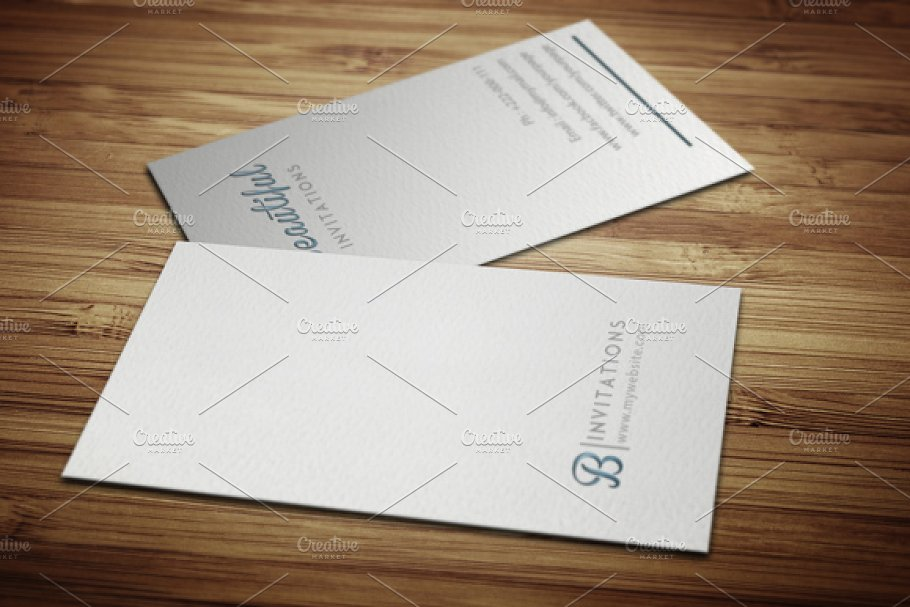 Two Letterpress White Flyer On Wooden Table Mockup