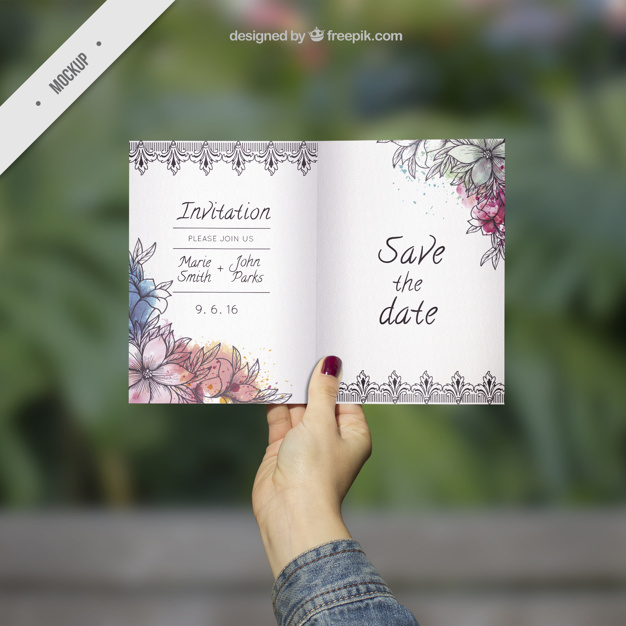 Wedding Invitation Card in Hand With Watercolor Flower PSD.