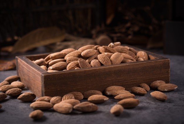 Wooden box filled with almond Mockup