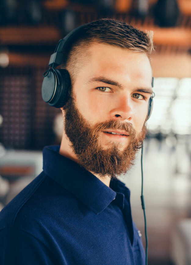 Young Man Listening Music On His Headphone Mockup.