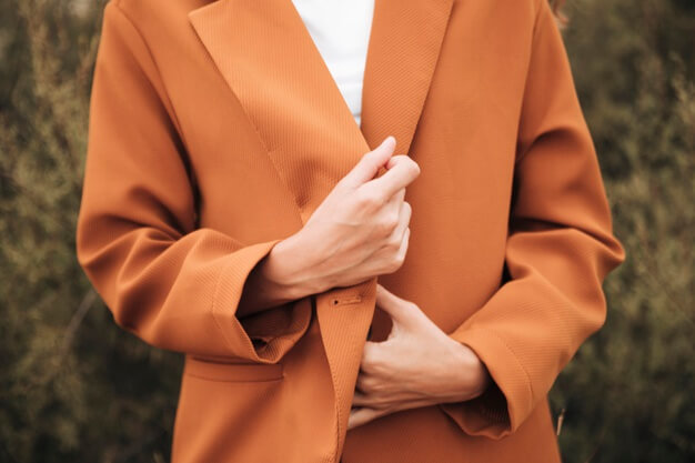 Close-up woman in a trench coat Free Photo