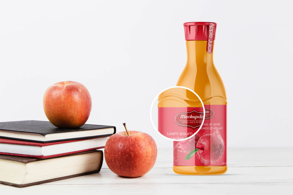 Closeup of a Free Apple Juice Bottle Mockup PSD Template