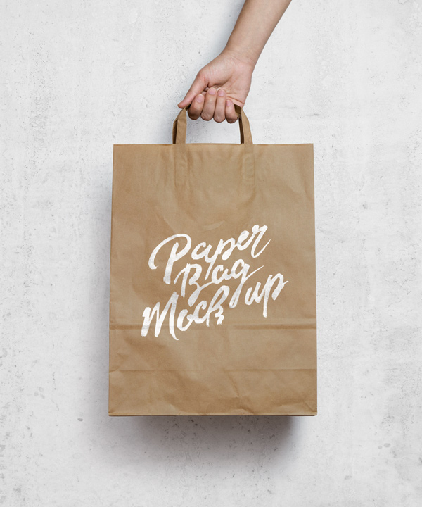 Hand held Brown Paper Shopping Bag Mockup