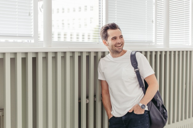 Happy student with a backpack looking away Mockup