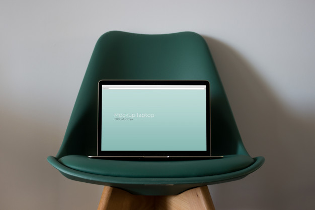 Laptop mockup on chair Free Psd