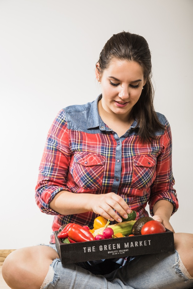 Woman picking vegetables wearing Polo Shirt PSD Mockup:
