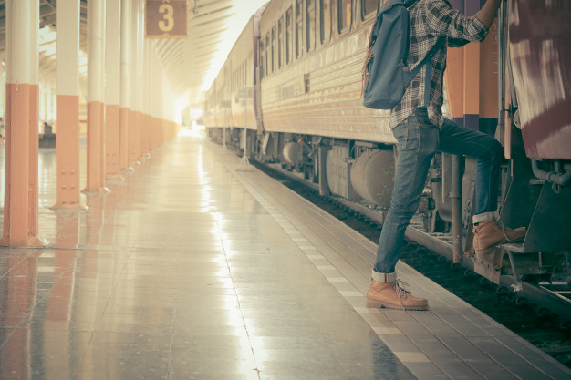 Young guy boarding the train with his backpack PSD Mockup