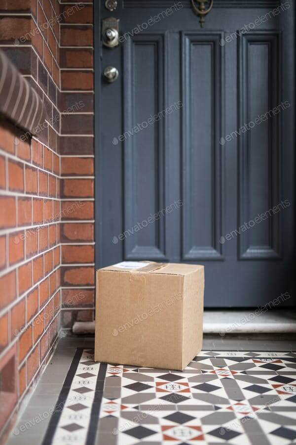A parcel delivery of a brown cardboard box containing goods purchased online and delivered