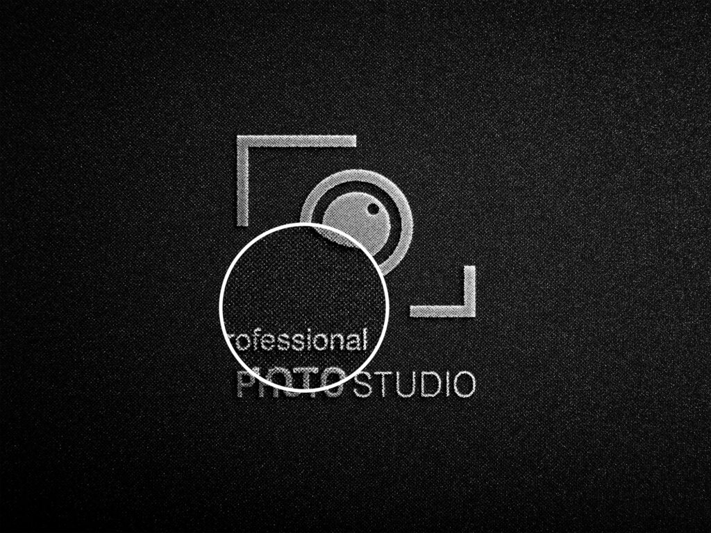 Close Up Of a Free Photography Logo Mockup PSD Template