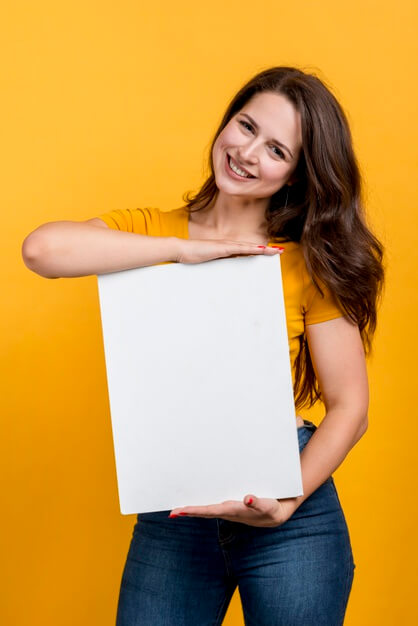 Smiling girl showing a blank poster Free Photo