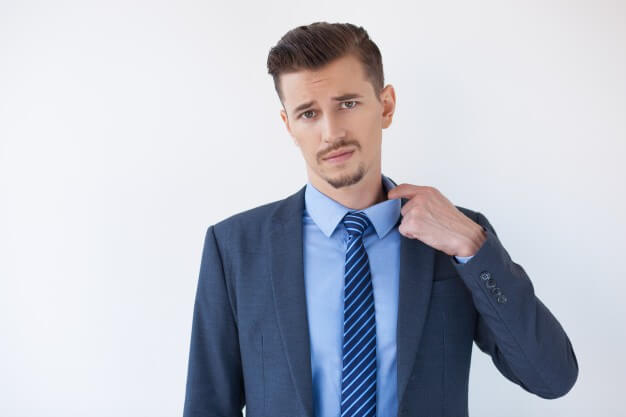 Tired business man feeling hot and pulling collar Free Photo