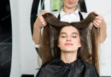 happy young woman with beautiful hair in hair salon (1)