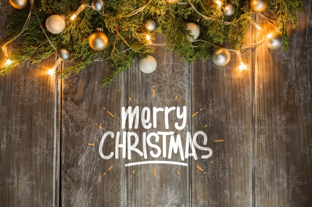 Christmas lighted coronet on wooden table Free Psd (1)
