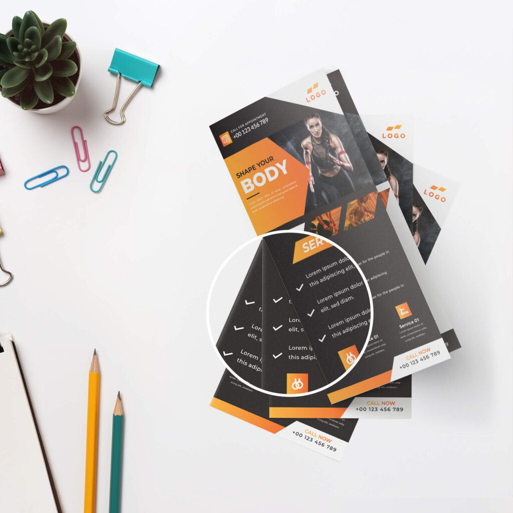 Close Up Of a Free Dl Flyer Mockup PSD Template