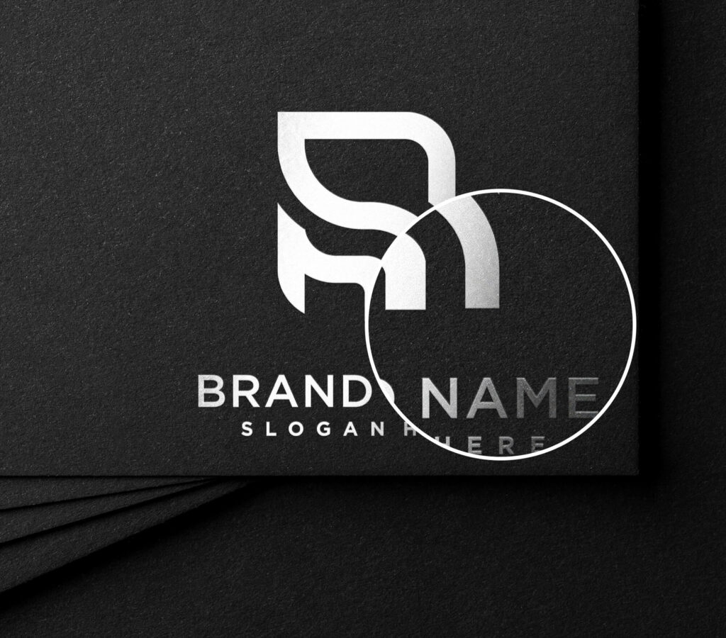 Close Up Of a Free silver stamping logo mockup PSD Template