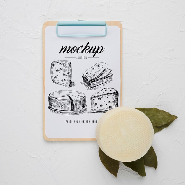 Flat lay of notepad with cheese Free Psd