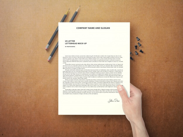 Hand holding document mock up Free Psd