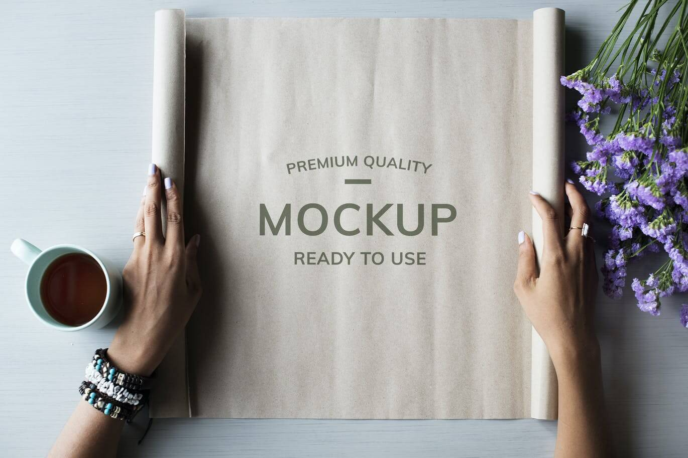 Hands opening paper roll mockup
