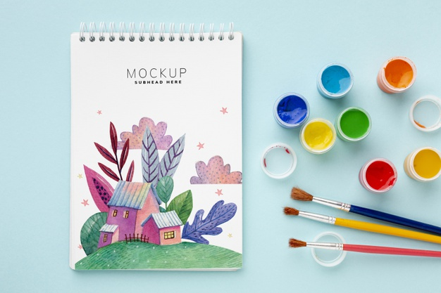 Notebook with watercolors and brushes Free Psd