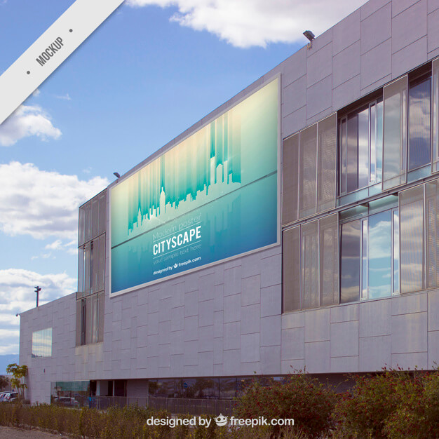 Outdoor billboard on a modern building Free Psd