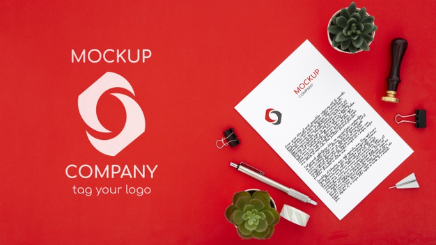 Top view of desk surface with succulents and document Free Psd