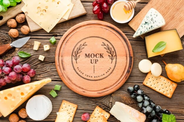 Top view of mock-up assortment of locally grown cheese with grapes Free Psd