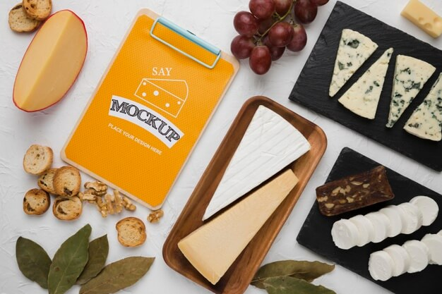 Top view of notepad with cheese and walnuts Free Psd