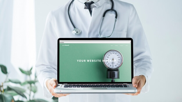 Doctor holding laptop mockup for website Free Psd
