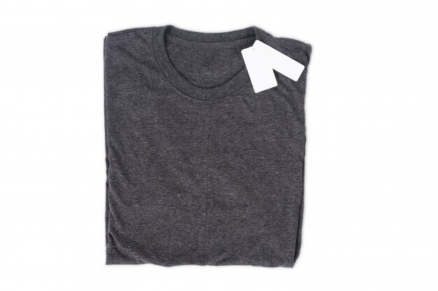 Folded t-shirt with tag isolate on white background with clipping path for design mockup Premium Photo
