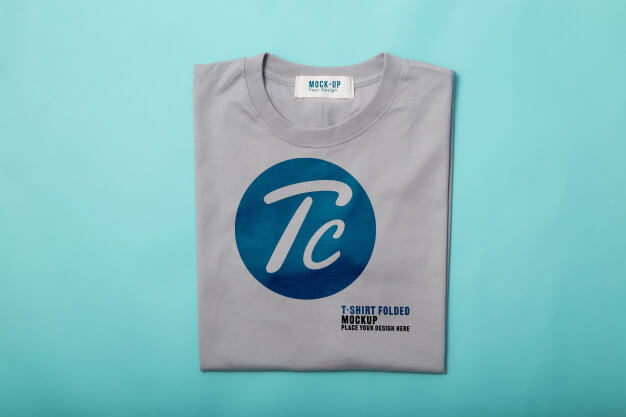 Grey folded t-shirts mockup template for your design on blue background Premium Psd