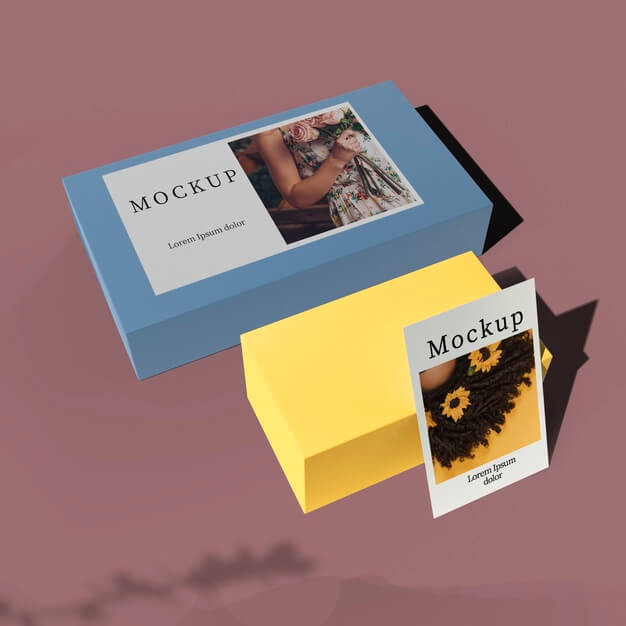 High angle of card on boxes with shadow Free Psd